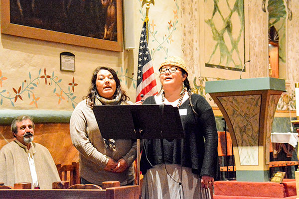 Members of the Santa Ynez Band of Chumash Indians Nakia Zavalla and Kathleen Marshall sing in their native tongue