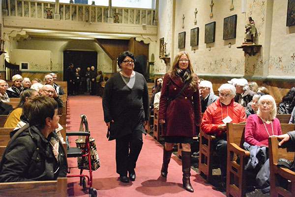 Mission Santa Barbara Executive Director Monica Orozco and Santa Barbara Trust Executive Director Anne Peterson enter the church