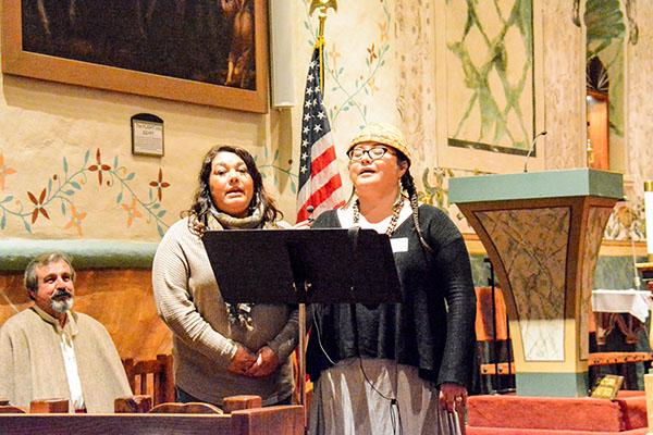 Members of the Santa Ynez Band of Chumash Indians Nakia Zavalla and Kathleen Marshall sing in their native tongue